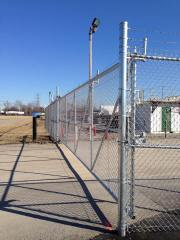 Chain Link Cantilever Gate with Barbed Wire