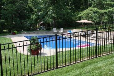 Ornamental Fence Around A Pool