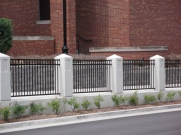 Ornamental Fence Between Columns