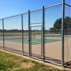 Chain Link Fence On A Tennis Court